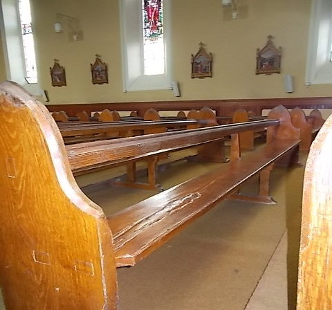 Seats in Ballygarret church, fashioned from timbers from the wreck of the Irrawaddy.